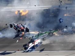 Drivers crash during a 15-car wreck at Las Vegas Motor Speedway on Oct. 16 that killed Dan Wheldon.