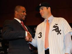 "White Sox GM Ken Williams, left, introducing Robin Ventura as the team's new manager, says of rebuilding, ""I have not used that word in 12 years."""