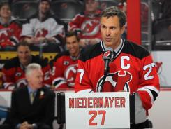 Former Devils star Scott Niedermayer takes part in his jersey retirement ceremony prior to the club's game against the Stars on Friday. Niedermayer led New Jersey to titles in 1995, 2000 and 2003.