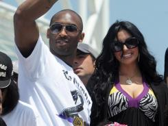 Kobe Bryant, left, won't be celebrating any future NBA titles with his wife after Vanessa Bryant filed for divorce.