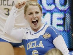 UCLA's Lainey Gera celebrates the Bruins' victory over Florida State Thursday in the NCAA women's volleyball semifinals.