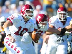 Quarterback (10) Chris Coyer looks downfield for a receiver during Temple's 37-15 win over Wyoming in the New Mexico Bowl.