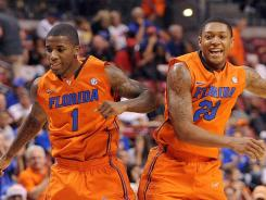 Florida Gators guards Kenny Boynton (left) and Bradley Beal celebrate during the first half at the BankAtlantic Center in Sunrise, Fla.