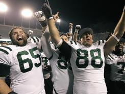 Ohio's Skyler Allen (65) and Jordan Thompson (88) celebrate after defeating Utah State in the Famous Idaho Potato Bowl in Boise.