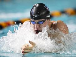 American Brendan Hansen won the 100-meter breaststroke event at the Duel in the Pool, edging world champion Daniel Gyurta of Hungary.