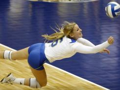 UCLA's Lainey Gera dives for a shot against Illinois at the Alamodome in San Antonio.