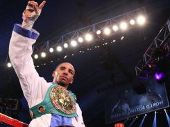 Andre Ward celebrates defeating Carl Froch during their WBA/WBC Super Middleweight Championship bout at Boardwalk Hall in Atlantic City Saturday.