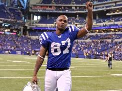 The Colts' Reggie Wayne waves to the crowd after beating the Tennessee Titans 27-13 in Indianapolis.