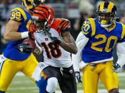 wide receiver A.J. Green (18) runs after a pass completion for 31 yards against the St. Louis Rams during the first half.