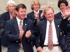 Golf Hall of Famers Nick Faldo, left, and Johnny Miller, center, seen here with Sam Snead in 1998, will be spending some time together in the NBC broadcast booth.