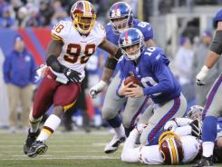 Washington Redskins defensive end Stephen Bowen sacks New York Giants quarterback Eli Manning during the fourth quarter.