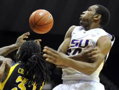 Storm Warren, right, and LSU handed Jae Crowder and Marquette their first loss of the season.