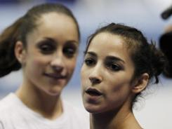 American gymnasts Aly Raisman and Jordyn Wieber, behind, at the world championships in Tokyo in October.