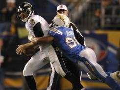 Linebacker Antwan Barnes, right, wraps up Joe Flacco for one of his four sacks in the Chargers' 34-14 win against the Ravens on Sunday. San Diego had seven sacks in the game.