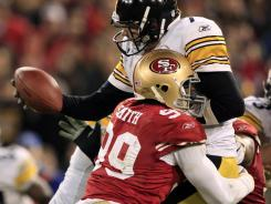 Aldon Smith (99) brings down Ben Roethlisberger for one of his 2.5 sacks on the night.