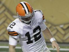 Cleveland Browns quarterback Colt McCoy gets up slowly after suffering a concussion on Dec. 8 in Pittsburgh.