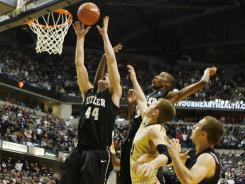 Butler Bulldogs forward Andrew Smith (44) tips in the winning basket with one second left in the game to defeat the Purdue Boilermakers at Conseco Fieldhouse. Butler defeats Purdue 67-65.