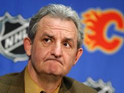 Darryl Sutter, shown in this Jan. 31, 2010 photo when he was Calgary Flames general manager, will assume his duties as coach of the Los Angeles Kings beginning with practice on Wednesday.