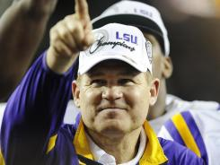 Les Miles has been chosen as coach of the  year by the Associated Press after leading LSU to the BCS championship game and an undefeated season.