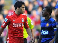 Liverpool's  Luis Suarez, left, and Manchester United's Patrice Evra exchange words. Suarez was fined 40,000 pounds and suspended eight games for issuing a slur during the spat.