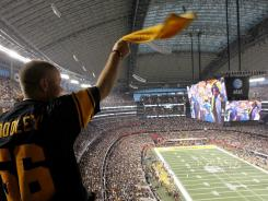 A Steelers fan watches Super Bowl XLV at Cowboys Stadium in Arlington, Texas.