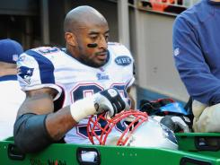New England defensive end Andre Carter is taken off the field after injuring his left quadriceps late in the first quarter of Sunday's 41-23 win over Denver.
