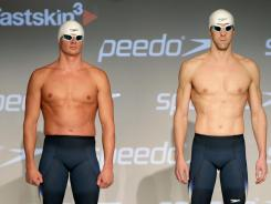 Ryan Lochte (left) and Michael Phelps model Speedo's new Fastskin 3 swimsuit during a news conference in New York, on Nov. 30. Lochte beat Phelps twice in head-to-head races at the 2011 world championships.