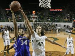 Baylor's Brittney Griner blocks a shot by McNeese State's Martika Hull in the first half of Baylor's 90-50 victory. Before the game, Griner was honored as the Big 12's all-time leading shot blocker.