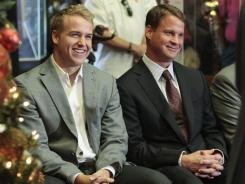 Southern California quarterback Matt Barkley, left, sits with coach Lane Kiffin before announcing he will stay in school for his senior season.