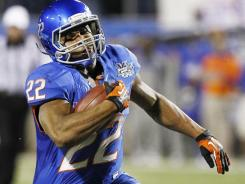 Boise State's Doug Martin takes the opening kickoff back 100 yards for a touchdown in the MAACO Bowl on Thursday night in Las Vegas.