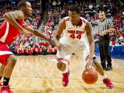 Ohio State guard William Buford (44) drives past Miami forward Josh Sewell at Nationwide Arena in Columbus, Ohio.