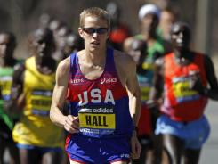 Ryan Hall runs ahead of a group of elite runners during the Boston Marathon in Wellesley, Mass., on April 18. Hall finished fourth in the event.