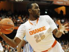 Syracuse forward Rakeem Christmas pulls in a rebound and starts a fast break against Tulane at the Carrier Dome in Syracuse, N.Y.