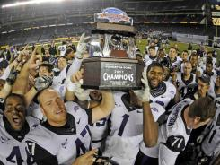 TCU players celebrate their come-from-behind Poinsettia Bowl victory, the Horned Frogs' final game before joining the Big 12 next season.