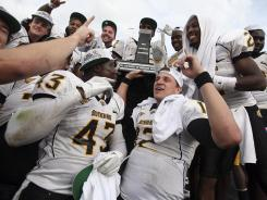 Southern Mississippi players celebrate after winning the Conference USA championship title game against Houston.
