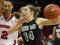 Green Bay guard Megan Lukan (14) drives against Wisconsin guard Taylor Wurtz during the first half at the Kohl Center in Madison, Wisc.
