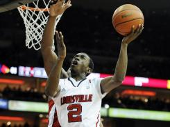 Louisville guard Russ Smith shoots against Western Kentucky during the second half at the KFC Yum! Center.