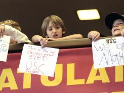 Young USC fans show their appreciation after Southern California quarterback Matt Barkley announced that he will play his senior year for the Trojans.
