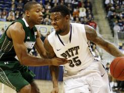 Pittsburgh forward Nasir Robinson (35) drives against Wagner forward Josh Thompson during the first half at the Petersen Events Center.
