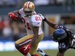 San Francisco running back Frank Gore (21) shakes of Seattle's Richard Sherman in the second half.