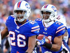 Buffalo Bills free safety Jairus Byrd, right, returns a Tim Tebow interception for a touchdown in the fourth quarter.