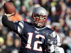 The Patriots' Tom Brady throws for a first down against the Dolphins in Foxborough, Mass.