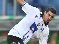 Atalanta Midfielder Cristiano Doni was banned from soccer for 3 1/2 years by the Italian football federation's disciplinary committee.