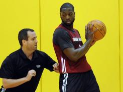 Some of the side-to-side moves Miami Heat guard Dwyane Wade makes with the ball to draw a foul will be looked at more closely by NBA referees this season.