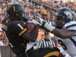 Southern Miss wide receiver Tracy Lampley (1) catches a touchdown pass over Nevada defensive back Marlon Johnson during the Hawaii Bowl at Aloha Stadium in Honolulu.