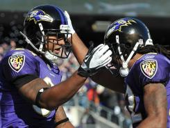 The Ravens' Ed Dickson, left, celebrates his touchdown with Torrey Smith against the Cleveland Browns at MT Bank Stadium in Baltimore.