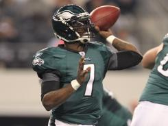 Eliminated from playoff contention before taking the field, Michael Vick threw two TDs to lead the Eagles past the Cowboys.