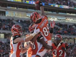 The Bengals' Jerome Simpson (89) celebrates with teammates following a 19-yard touchdown reception in Cincinnati's 23-16 win over the Arizona Cardinals on Saturday.