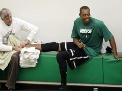 Boston Celtics forward Paul Pierce, right, missed Sunday's season opener with a bruised right heel.