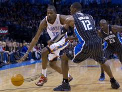 Thunder small forward Kevin Durant, left, drives past Magic center Dwight Howard during the second quarter of their game at Chesapeake Energy Arena. Durant had a game-high 30 points in Oklahoma City's win.